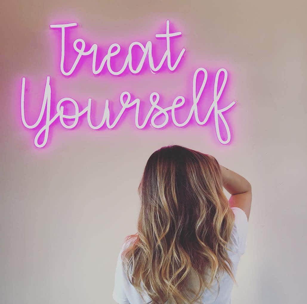 Treat Yourself neon sign
