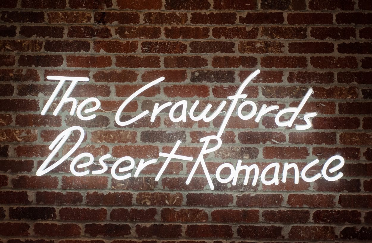 the Crawfords Desert Romance neon sign
