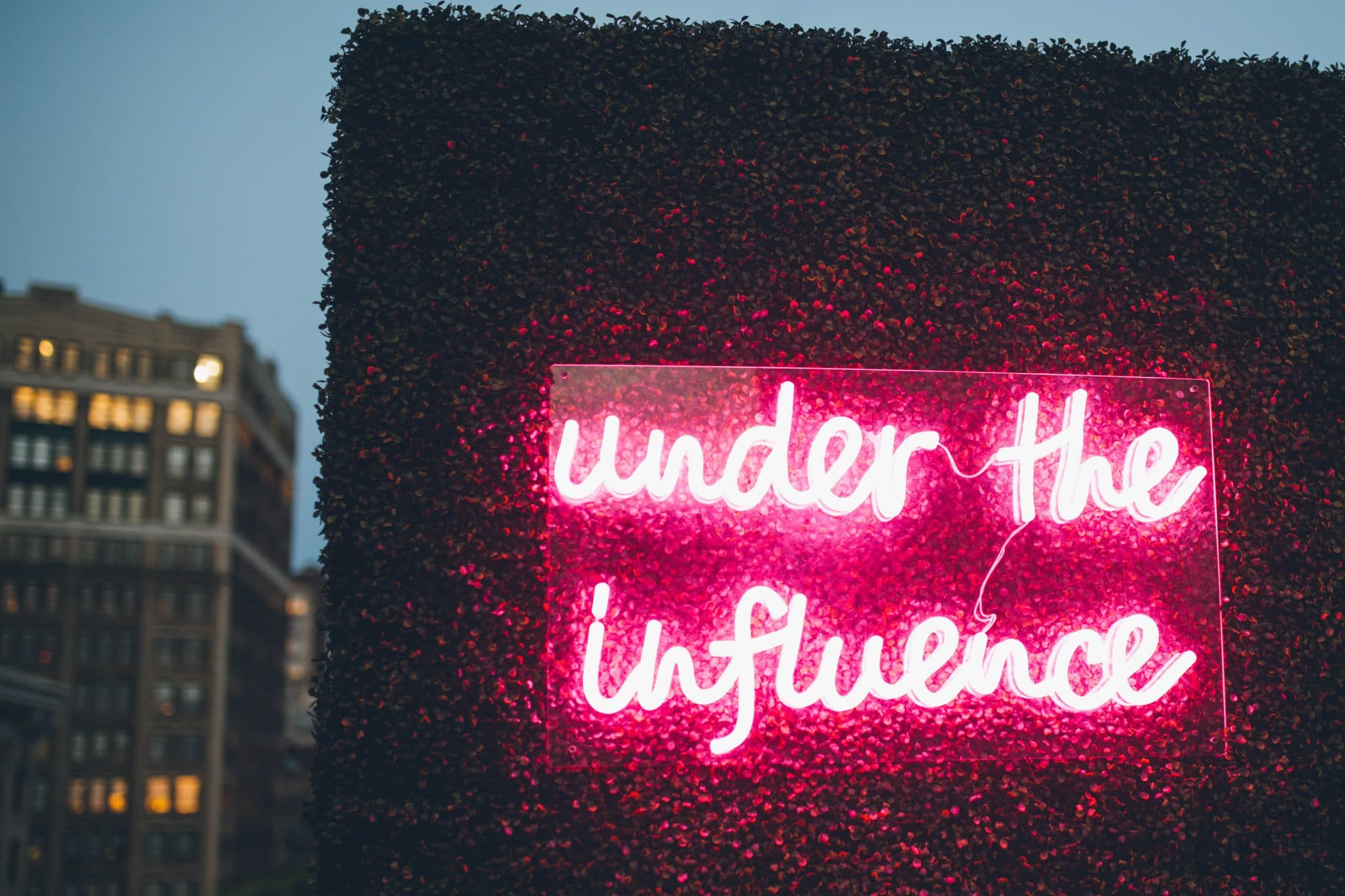 under the influence neon sign