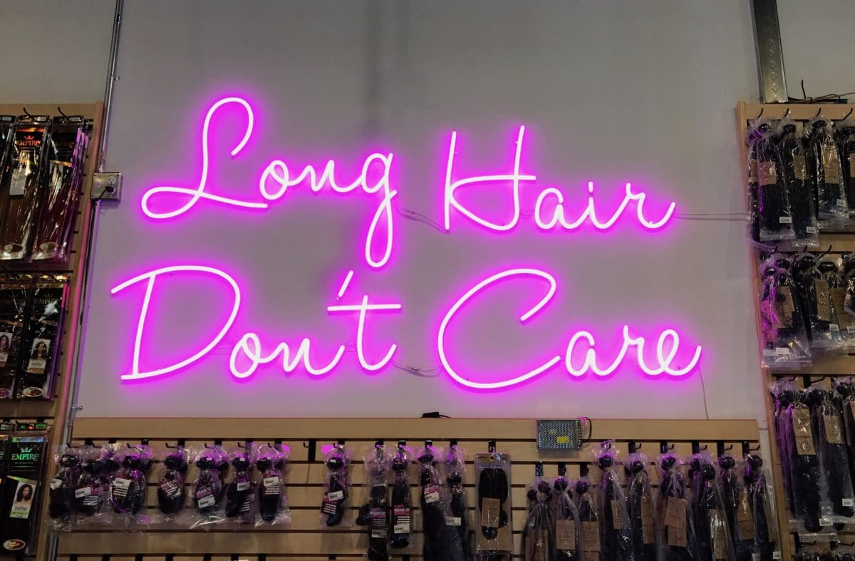 long hair don't care neon sign