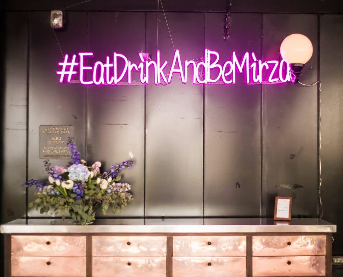 #EatDrinkAndBeMirza neon sign