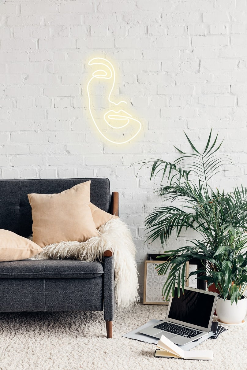 neon sign on couch